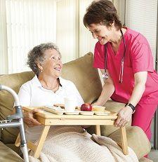 Nurse providing meals