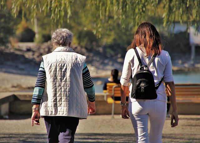 Elderly woman and adult woman walking together